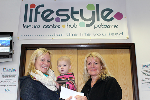 Denise presenting a cheque to Judith and Josie