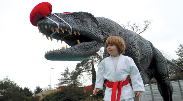 James from Ferndown Jitsu Club with Darren the Dinosaur