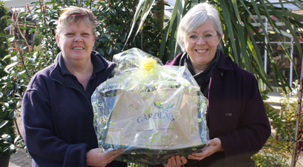 Fran Powell from Castle Gardens presenting Mrs Eaton of Christchurch with a new birdhouse and feeder
