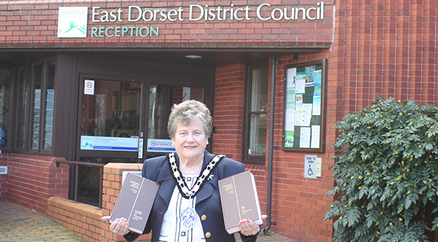 Cllr Lucy Clark with legal books