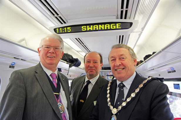 Making history – from left are Dorset County Council chairman Cllr John Wilson, Swanage Railway Company chairman Peter Sills and Swanage Mayor Cllr Bill Trite