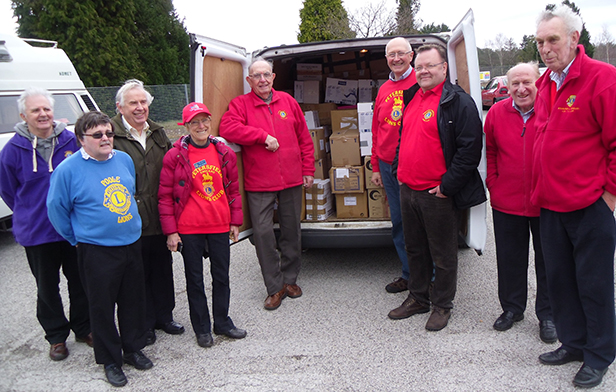 Pictured are some Lions members with the 22,000 pairs of specs