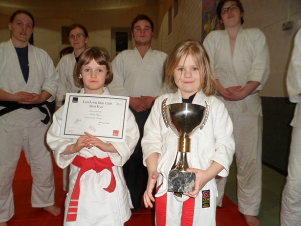 Mini Jitsu Students Seren presented with her promotion certificate and her best friend Libby May who was awarded the student of the week
