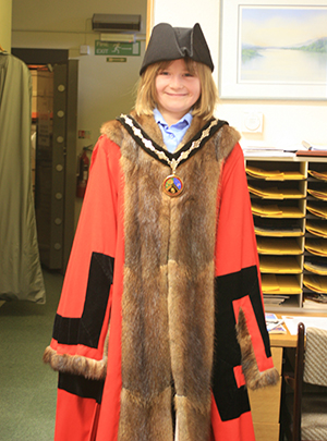 Trying on the mayor's robes