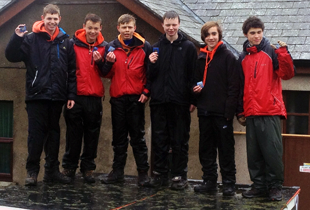 The boys on the podium after successfully completing the Ten Tors Challenge. (l-r) Charlie Pike, James Bourton, Dan Harwood, Lewis Roberts, Dan Payne and Higor Schneider
