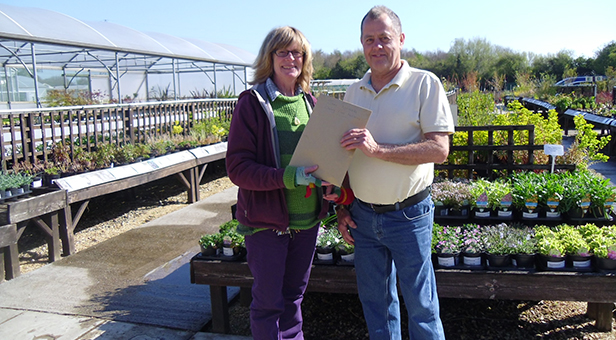 Peter Baker presents the cheque to a member of staff at Cherry Tree Nursery
