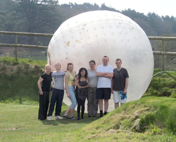 Staff from the Punch and Judy Bakery taking part in Zorbing for charity