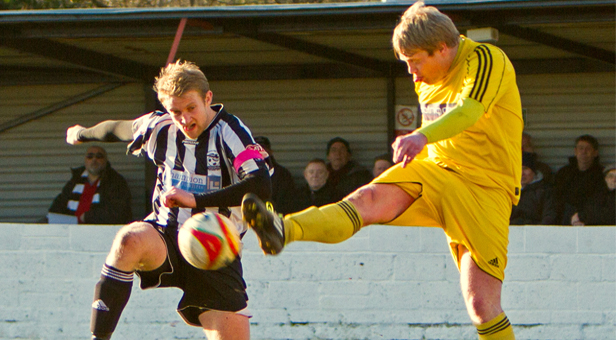 PHOTO: Jon Blake (left) in action for Wimborne Town PICTURE BY SIMON CARLTON