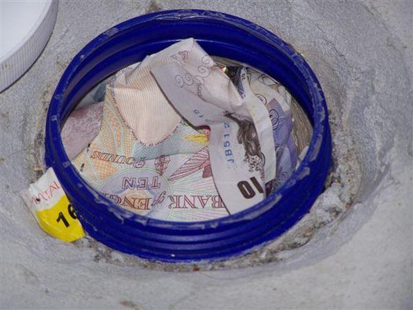Money found under floor tiles