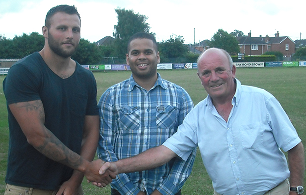 Club Chairman Peter Pearce congratulates Duncan Soden on his new role with Andrew Douch looking on
