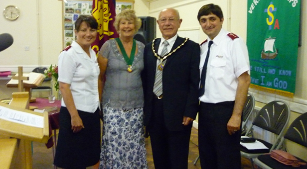 Captains Gia and Eka along with the Verwood Mayor Councillor Peter Richardson and the Mayoress Mrs Rosemary Richardson at their induction by Major Howard Webber