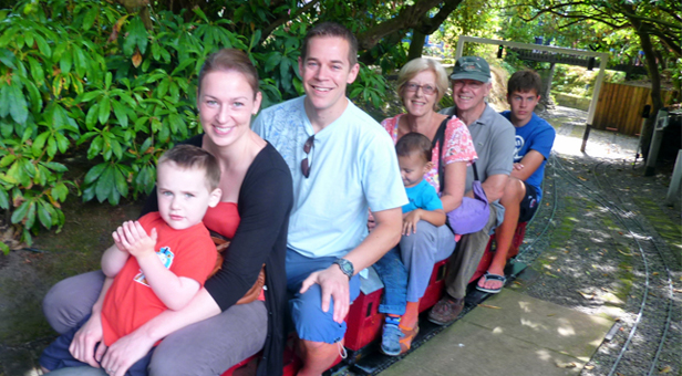 PHOTO:  WORLDWIDE VISITORS ENJOY THE 'MINIATURE' RAILWAY IN LILLIPUT: James, Michelle and Andrew (from Surrey), Cubie (from Hong Kong), Janice and David (from Lilliput) and Sam (from Kenya) © Andrew Funnell