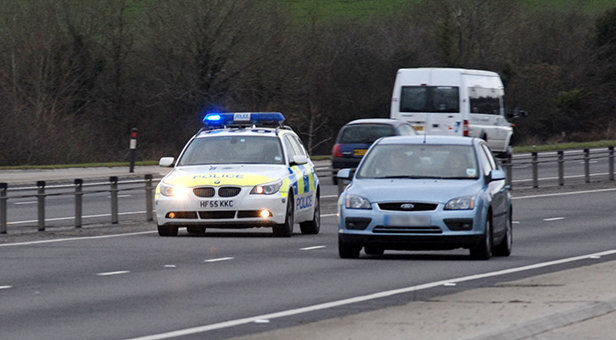 Police car pursuing speeding vehicle