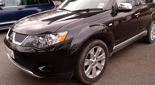 Black car in car park