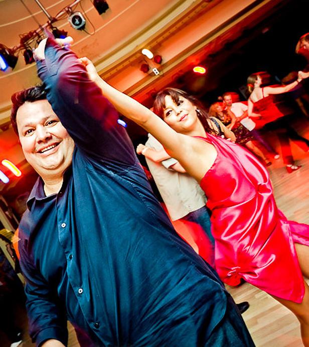 Enrique Perez and partner salsa dancing