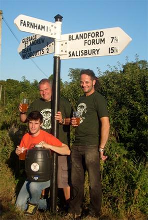 L-R Simon Meaden, Adam Batty and Bill Meaden under their new fingerpost in Minchington.