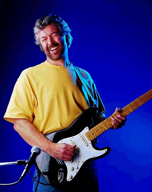 Mike Hall as Eric Clapton