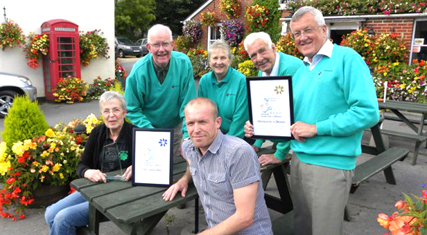 Front: Margaret Kiff and Andrew Kiff (her son and the Green Man's landlord) with their trophies and back: Anthony Oliver, Mary Allen (committee members), John Hare-Brown (secretary) and Richard Nunn (chairman)