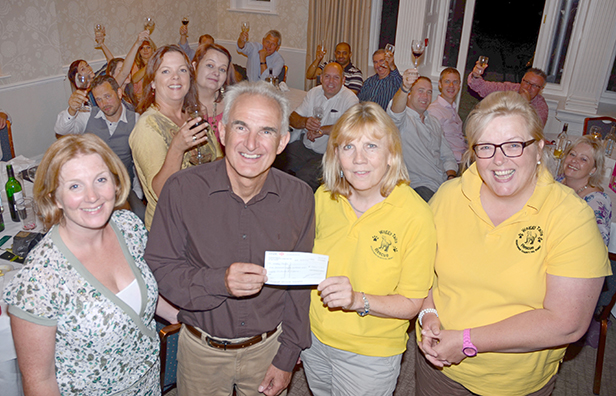 PamPurredPets' Charlotte Sturmey and Steve Fowler present cheque to Waggy Tails's Chrissie Davies and Sally Troth at the Moorhill House Hotel