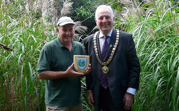 Neil Lucas (left) receiving his plaque from the Mayor of Ferndown