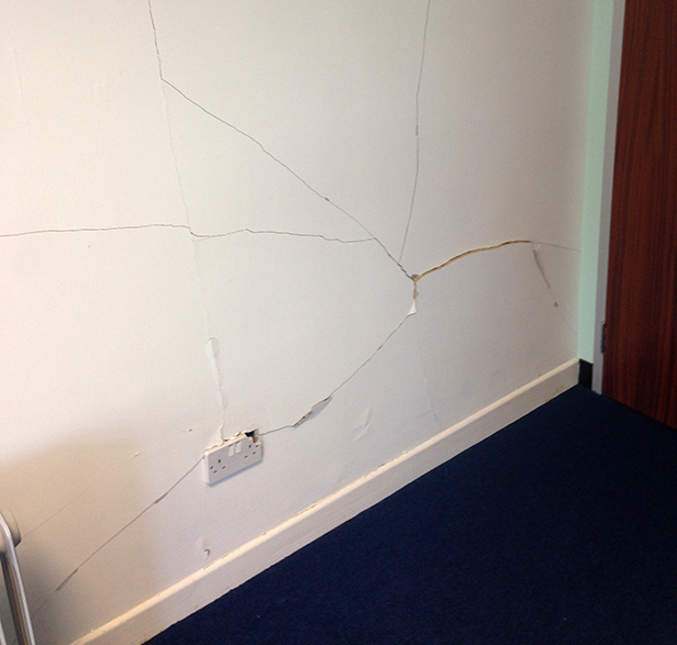 Damaged wall in Wessex Denture Studio