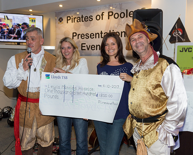 Pirates of Poole present a cheque for £1,800 to Lewis-Manning Hospice