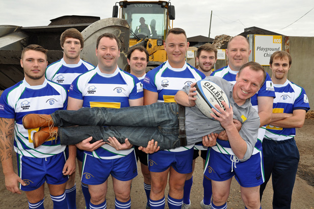 Peter Hardy, Eco's Commercial Manager, is given a lift by players from Oakmeadians RFC's 1st XV squad