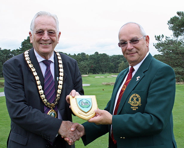Mayor of Ferndown Cllr John Lewis presenting cheque to club captain Barry Vincent