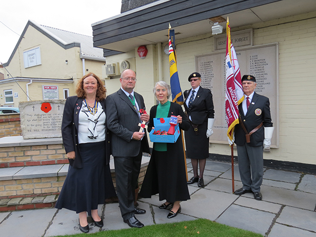Deputy Mayor Steve Lugg buys the first poppy from Diane Ridge, Ferndown RBL poppy organiser, watched by branch chairman Pat Birch and standard bearers Zoe Major and Ray Wrigglesworth