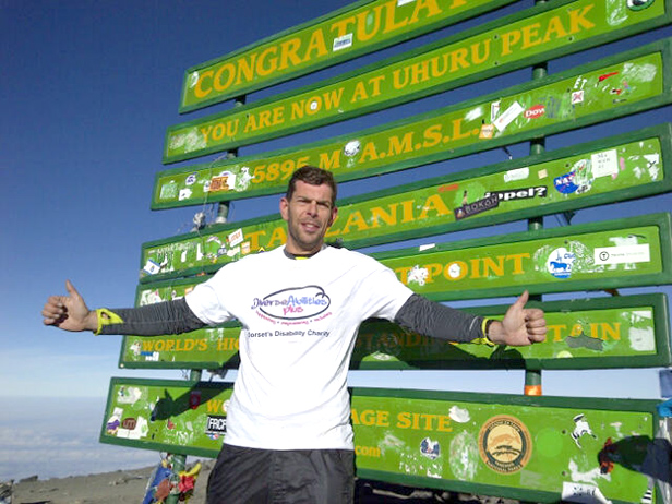 Gary Knight at the top of Kilimanjaro