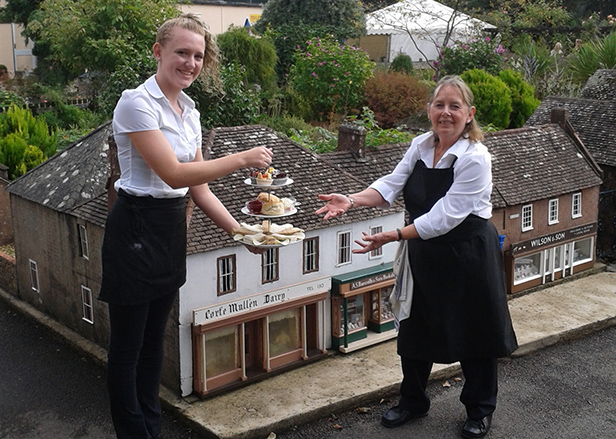 Olivia Row (LEFT) & Marion Bailey (RIGHT) with high tea in the Model Town Square