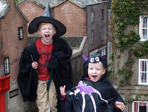 Halloween spooks Joseph (left) and Jonathan Walters (right) prepare for Halloween fun