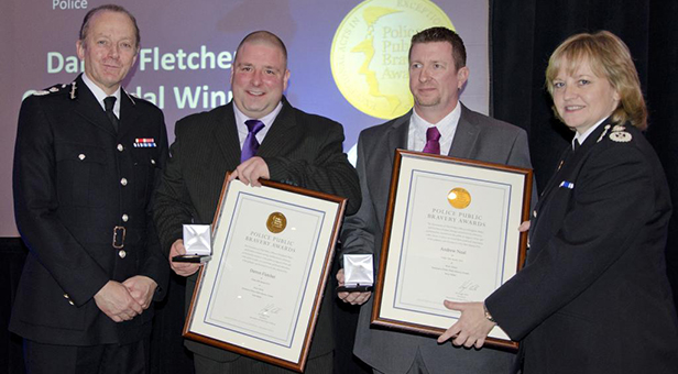 Darren Fletcher and Andrew Neal receiving their awards at the National Police Public Bravery Awards on 19 November. L-R Sir Hugh Orde presents awards to winners Darren Fletcher and Andrew Neal with Dorset Police's Chief Constable Debbie Simpson