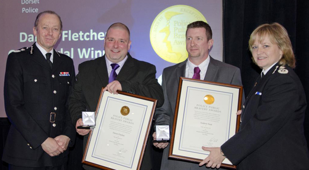L-R Sir Hugh Orde presents awards to winners Darren Fletcher and Andrew Neal with Dorset Police's Chief Constable Debbie Simpson.