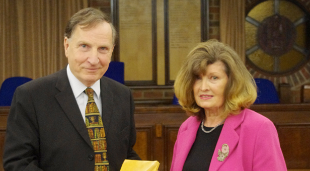 Tom Durham received the Quill from Linda Patterson, chairman of CADArts (Christchurch and District Arts Council)