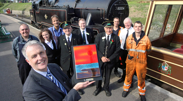 Swanage Railway general manager Richard Jones with the tourism award and some of the staff who run the heritage railway which carries some 200,000 passengers a year.
