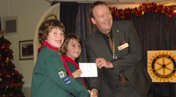 Saturn Cubs receive a cheque from Verwood Rotary's President Anthony Inman