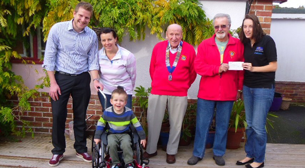 Stanley's parents Anthony and Leela with Lion President Frank Forte, welfare chairman Barry Duxbury and Kirstie Hellings of HMS Mobility Solutions