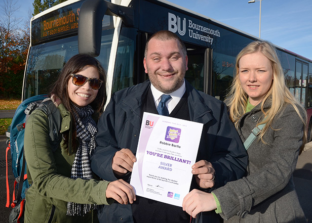 Robbie Bartle with certificate and two student fans Amanda Wong (left) and Shoned Jones