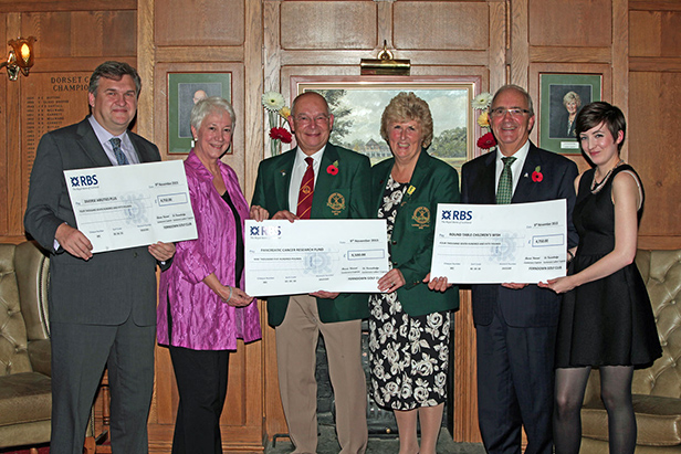 (left-right) Mark Powell, CEO of Diverse Abilities Plus, Maggie Blanks, CEO and Founder of Pancreatic Cancer Research Fund, Barrie Vincent, Ferndown Golf Club's Centenary Captain, Di Groombridge, Ferndown Golf Club's Ladies Centenary Captain, Bob Eveleigh, Charlotte Otter, both from Round Table Children's Wish