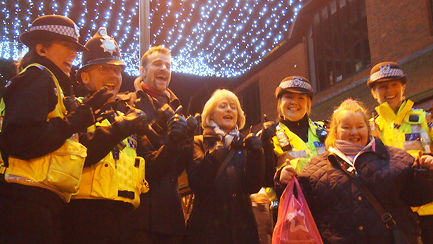Steve Harris with Dawn Egging (centre) under the raft of lights in Penny's Walk