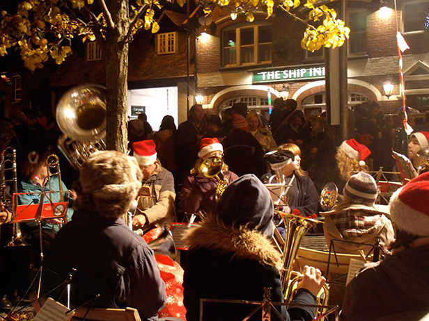 The brass band plays under the Christmas tree