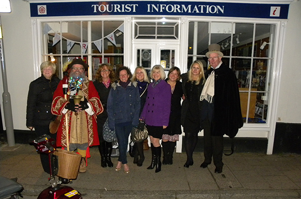 Fond farewell: Tourist information staff in Wimborne with Chris Brown and Anthony Oliver following the switching on of the Christmas lights
