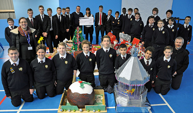 Students and teachers from Harewood College with staff from the BCHA with the Christmas hampers for the homeless