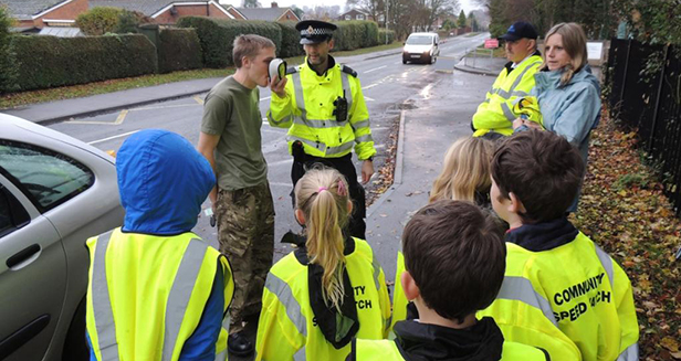 Students with L-R member of the public, Police Constable Rob Hammond, Deputy Community Speed Watch Co-ordinator Chris Durham and Archbishop Wake head teacher Jo Hicks