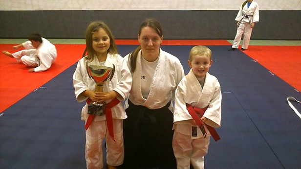 Student of the week Isabella with Sensei Fiona and  latest member Taylor with his red belt at Ferndown Jitsu Club