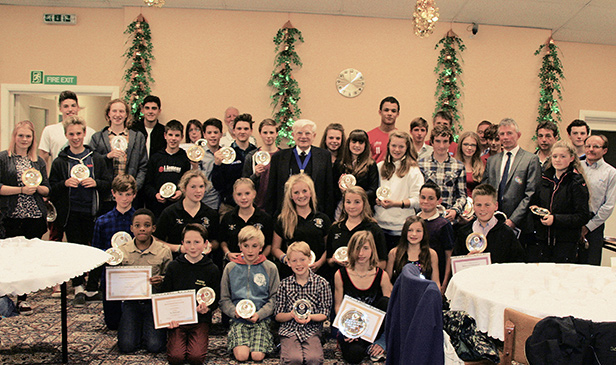 Photo of some of the winners with their awards