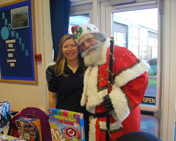 Alison Morris from Hamworthy Heating is Santa's little helper at the Forest Holme Christmas Fair at Upton School