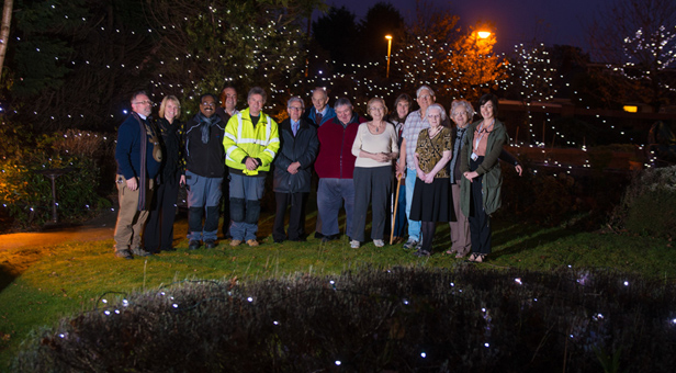 Zone 8 Panel members and residents at Turbary Court on Tuesday evening when the lights were switched on