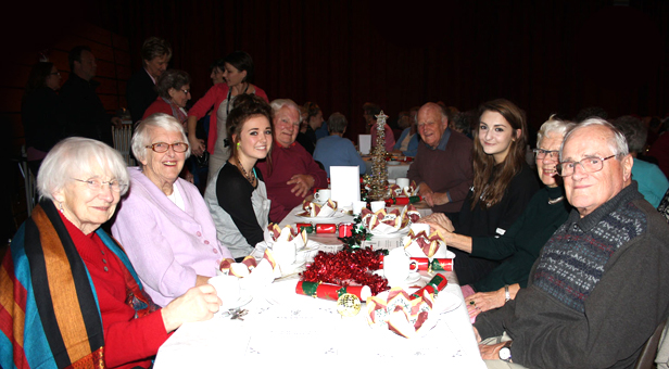 Ringwood School's Sixth Form students celebrate a successful evening with senior citizens